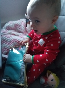 Leona getting excited about the diaper bag
