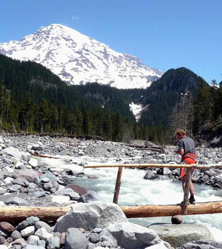 A-hiker-crosses-the-Nisqually-on-the-bridge-near-Cougar-Rock.-Paradise-River-Karen-S